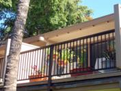 A102 - Upper lanai from private grassed area. Total lanai area is 224 sq. ft.