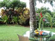 A102 - Landscaped area from front door across covered lanai
